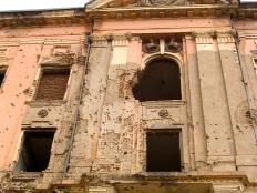 Bullet-ridden palace ruins